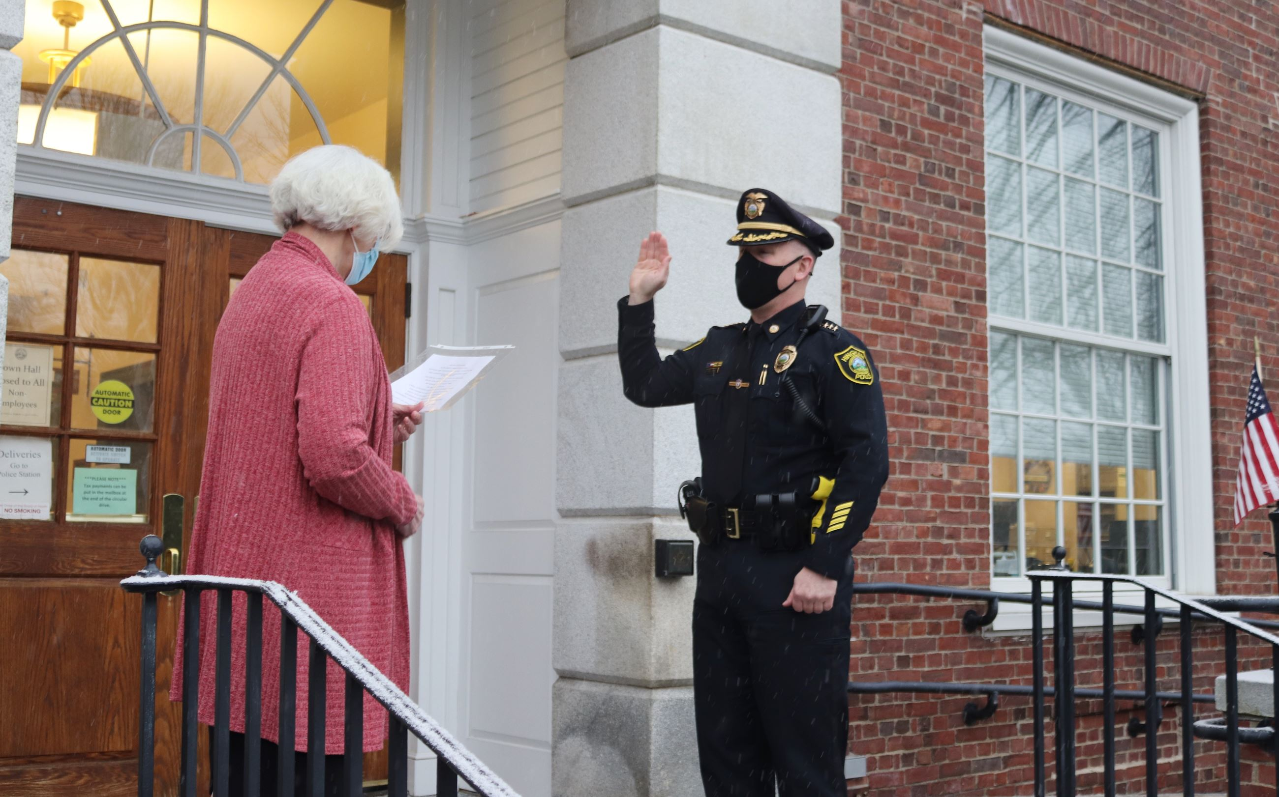Chief David Jones raising his hand as he is sworn in as Police Chief